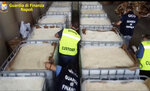 This image taken from a video shows customs police officers inspecting boxes full of amphetamines pills that were seized at the Salerno harbor, southern Italy, Wednesday, July 1, 2020. Italian police have seized 14 tons of amphetamines, allegedly produced in Syria by Islamic State group to fund terrorist activities and destined for the European illegal drug market. Customs Police Col. Domenico Napolitano on Wednesday called the discovery of three shipping containers crammed with some 85 million pills, in the southern port of Salerno, the biggest amphetamine seizure ever made worldwide. (Guardia di Finanza via AP)
