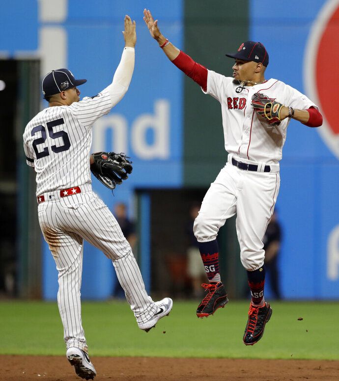 American League Gleyber Torres, left, of the New York Yankees, and American League Mookie Betts, of the Boston Red Sox, celebrate a 4-3 victory of the National League in the MLB baseball All-Star Game, Tuesday, July 9, 2019, in Cleveland. (AP Photo/Tony Dejak)