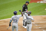Tampa Bay Rays' Brandon Lowe, right, celebrates his home run off Chicago White Sox starting pitcher Lance Lynn with Randy Arozarena during the third inning of a baseball game Monday, June 14, 2021, in Chicago. (AP Photo/Charles Rex Arbogast)