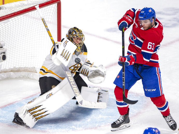 Boston Bruins goaltender Jaroslav Halak (41) stops Montreal Canadiens centre Matthew Peca (63) during third period NHL hockey action in Montreal on Monday, Dec. 17, 2018. (Ryan Remiorz/The Canadian Press via AP)
