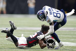 Atlanta Falcons safety Jaylinn Hawkins (32) hits Tennessee Titans wide receiver Fred Brown (82) during the first half of a preseason NFL football game, Friday, Aug. 13, 2021, in Atlanta. (AP Photo/Brynn Anderson)