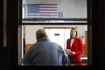 FILE - In this Nov. 11, 2019, file photo, Rep. Cindy Axne, D-Iowa, speaks to local residents at the American Legion Post 184 in Winterset, Iowa. Few states have changed politically with the head-snapping speed of Iowa. (AP Photo/Charlie Neibergall, File)