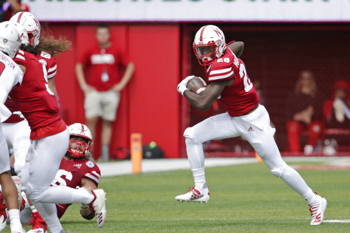Nebraska running back Maurice Washington (28) carries the ball during the second half of an NCAA college football game against South Alabama in Lincoln, Neb., Saturday, Aug. 31, 2019. Washington, who faces pornography charges in California stemming from an incident in high school, entered the No. 24 Cornhuskers' game against South Alabama in the third quarter. Nebraska won 35-21. (AP Photo/Nati Harnik)