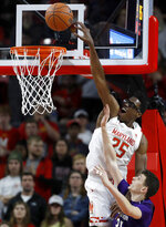 Maryland forward Jalen Smith (25) goes up for a basket against Northwestern forward Robbie Beran during the first half of an NCAA college basketball game, Tuesday, Feb. 18, 2020, in College Park, Md. (AP Photo/Julio Cortez)