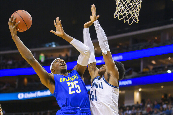 Villanova forward Saddiq Bey (41) defends Delaware forward Justyn Mutts (25) during the first half of the Never Forget Tribute Classic NCAA college basketball game, Saturday, Dec. 14, 2019, in Newark, N.J. (AP Photo/Corey Sipkin)