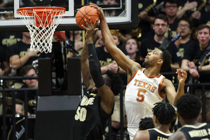 Texas forward Royce Hamm Jr. (5) gets his hand on the shot of Purdue forward Trevion Williams (50) in the first half of an NCAA college basketball game in West Lafayette, Ind., Saturday, Nov. 9, 2019. (AP Photo/AJ Mast)