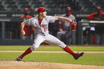 Cincinnati Reds starting pitcher Trevor Bauer delivers against the Chicago Cubs during the first inning of a baseball game Wednesday, Sept. 9, 2020, in Chicago. (AP Photo/Kamil Krzaczynski)