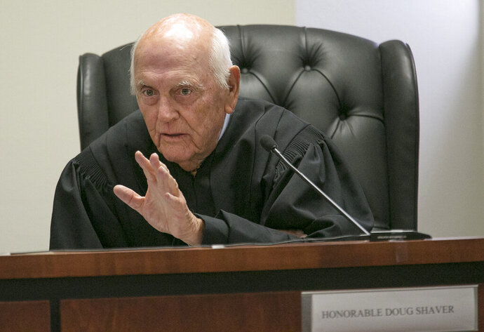 In this Oct. 10, 2017 photo, Bastrop County District Court Judge Doug Shaver listens to arguments from attorneys during a hearing in Austin, Texas, to reconsider testimony in Rodney Reed's murder trial in the slaying of Stacey Stites. A new judge has been assigned to death row inmate Rodney Reed's case, one week after the highest criminal court in Texas canceled his execution scheduled this month. The Austin American-Statesmen reports that Judge Olen Underwood replaced Judge Shaver on Thursday, Nov. 21, 2019, and assigned retired Brazos County Judge J.D. Langley to replace him. (Ralph Barrera/Austin American-Statesman via AP)