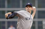 New York Yankees starting pitcher James Paxton (65) throws against the Houston Astros during the first inning of a baseball game Wednesday, April 10, 2019, in Houston. (AP Photo/Michael Wyke)
