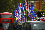 Various flags wave outside the houses of Parliament, in London, Monday, Oct. 21, 2019.  There are just 10 days until the U.K. is due to leave the European bloc on Oct. 31. (AP Photo/Alberto Pezzali)