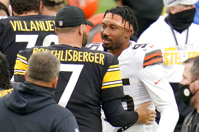 Pittsburgh Steelers quarterback Ben Roethlisberger (7) and Cleveland Browns defensive end Myles Garrett (95) meet on the field following an NFL football game in Pittsburgh, Sunday, Oct. 18, 2020. (AP Photo/Gene J. Puskar)