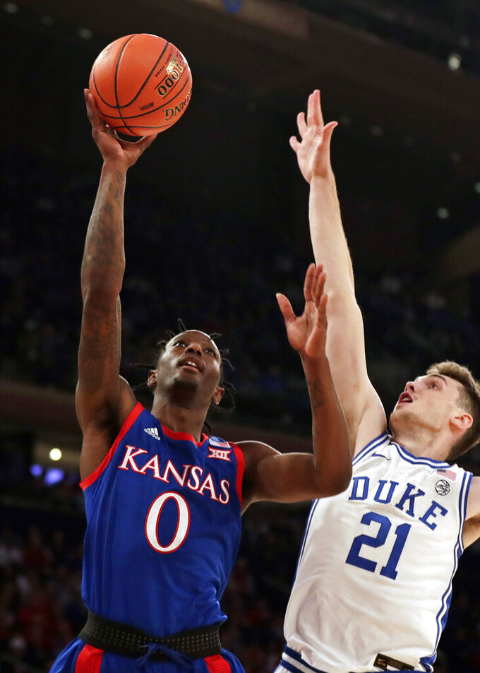 No. 4 Duke edges third-ranked Kansas 68-66