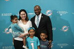 The new Miami Dolphin's head coach Brian Flores, left, poses for a portrait with his family, wife, Jennifer, daughter Liliana, son Miles, center, and son Maxwell, left, before he speaks during a news conference on Monday, Feb. 4, 2019, in Davie, Fla. Hours after his team won the Super Bowl, New England Patriots linebackers coach Flores has been hired as head coach of the Miami Dolphins.  (AP Photo/Brynn Anderson)
