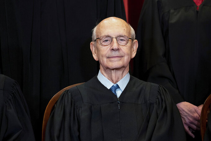 FILE - In this April 23, 2021, file photo, Supreme Court Associate Justice Stephen Breyer sits during a group photo at the Supreme Court in Washington.  Breyer could glide into retirement as the author of two of the Supreme Court's biggest cases this year. Or the 82-year-old liberal justice could reason that his pragmatic, collaborative approach to judging has never been more needed on the high court and decide to stick around. What will Breyer do? (Erin Schaff/The New York Times via AP, Pool, File)