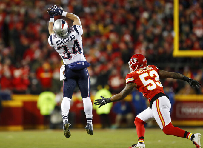 New England Patriots running back Rex Burkhead makes a catch against Kansas City Chiefs inside linebacker Anthony Hitchens (53) during the first half of the AFC Championship NFL football game, Sunday, Jan. 20, 2019, in Kansas City, Mo. (AP Photo/Jeff Roberson)