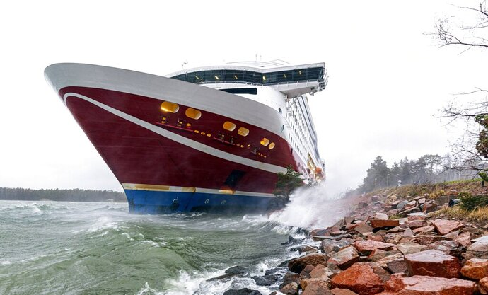 "A view of the Viking Line cruise ship Viking Grace, run aground with passengers on board, south of Mariehamn, Finland, Saturday, Nov. 21, 2020. A Baltic Sea ferry with 331 passengers and a crew of 98 has run aground in the Aland Islands archipelago between Finland and Sweden. Finnish authorities say there are ""no lives in immediate danger"" and the vessel isn't leaking. The Finnish coast guard tweeted Saturday afternoon that the Viking Line ferry that runs between the Finnish port city of Turku and Swedish capital Stockholm hit ground just off the port of Mariehamn, the capital of the Aland Islands. (Niclas Nordlund/Lehtikuva via AP )"