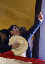 Pedro Castillo celebrates after being declared president-elect by election authorities, at his campaign headquarters in Lima, Peru, Monday, July 19, 2021. Castillo was declared president more than a month after elections took place and after opponent Keiko Fujimori claimed that the election was tainted by fraud. (AP Photo/Guadalupe Prado)