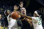 Oregon's Ruthy Hebard, left, and Minyon Moore, right, battle Arizona State's Jamie Ruden, center, for a loose ball during the first quarter of an NCAA college basketball game in Eugene, Ore., Sunday, Feb. 9, 2020. (AP Photo/Chris Pietsch)