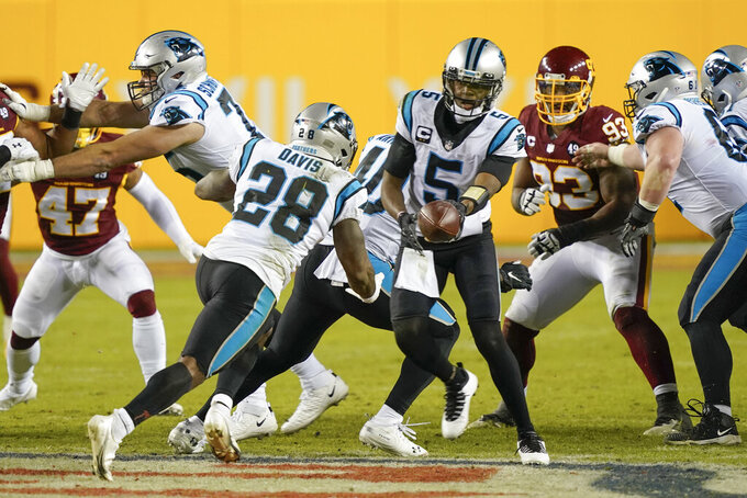 Carolina Panthers quarterback Teddy Bridgewater (5) hands the ball off to running back Mike Davis (28) during the second half of an NFL football game against the Washington Football Team, Sunday, Dec. 27, 2020, in Landover, Md. (AP Photo/Susan Walsh)