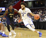Buffalo's Jeremy Harris (2) drives past Akron's Jimond Ivey (0) during the second half of an NCAA college basketball game of the Mid-American Conference tournament, Thursday, March 14, 2019, in Cleveland. Buffalo won 82-46. (AP Photo/Tony Dejak)