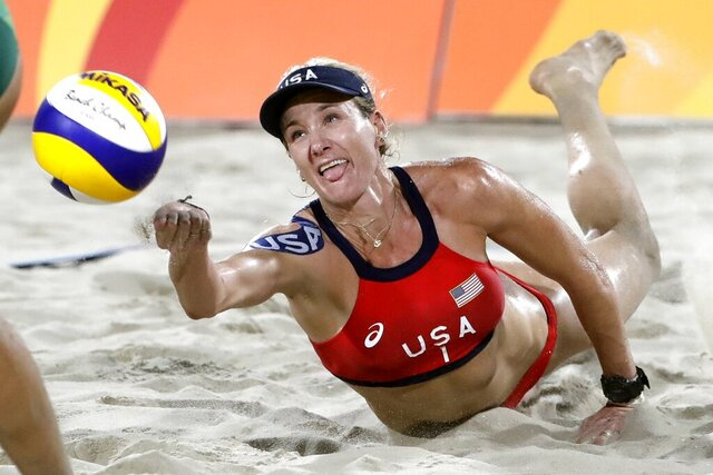 FILE - In this Aug. 17, 2016, file photo, United States' Kerri Walsh Jennings digs for a ball while playing Brazil during the women's beach volleyball bronze medal match of the 2016 Summer Olympics in Rio de Janeiro, Brazil. The volleyball star created a virtual summer camp in 2020 for young volleyball players and others seeking to stay active during the coronavirus pandemic. (AP Photo/Marcio Jose Sanchez, File)