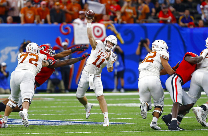 Texas quarterback Sam Ehlinger (11) throws a pass during the second half against Georgia in the Sugar Bowl NCAA college football game Tuesday, Jan. 1, 2019, in New Orleans. (AP Photo/Butch Dill)