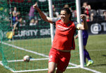 FILE - In this April 15, 2017, file photo, Portland Thorns forward Christine Sinclair celebrates scoring a goal during the second half of their NWSL soccer match against the Orlando Pride in Portland, Ore. The National Women's Soccer League opens its Challenge Cup tournament on Saturday, June 27, 2020, and the pressure is on as the first professional team sport in the United States to play amid the coronavirus pandemic. (AP Photo/Don Ryan, File)