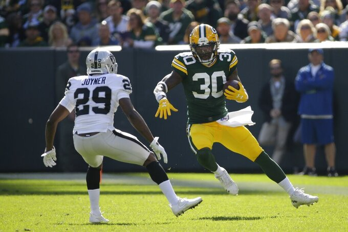 Green Bay Packers' Jamaal Williams runs during the first half of an NFL football game against the Oakland Raiders Sunday, Oct. 20, 2019, in Green Bay, Wis. (AP Photo/Mike Roemer)