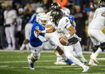 Tulsa defensive end Trevis Gipson (15) puts pressure on Central Florida quarterback Dillon Gabriel during the first half of an NCAA college football game, Friday, Nov. 8, 2019 in Tulsa, Okla. (Brett Rojo/Tulsa World via AP)