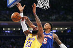 New York Knicks guard Elfrid Payton (6) tips the ball away from Los Angeles Lakers forward LeBron James (23) during the first half of an NBA basketball game in New York, Wednesday, Jan. 22, 2020. (AP Photo/Kathy Willens)