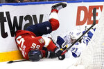 Florida Panthers center Noel Acciari (55) and Tampa Bay Lightning center Anthony Cirelli (71) fall to the ice during the first period in Game 5 of an NHL hockey Stanley Cup first-round playoff series, Monday, May 24, 2021, in Sunrise, Fla. (AP Photo/Lynne Sladky)