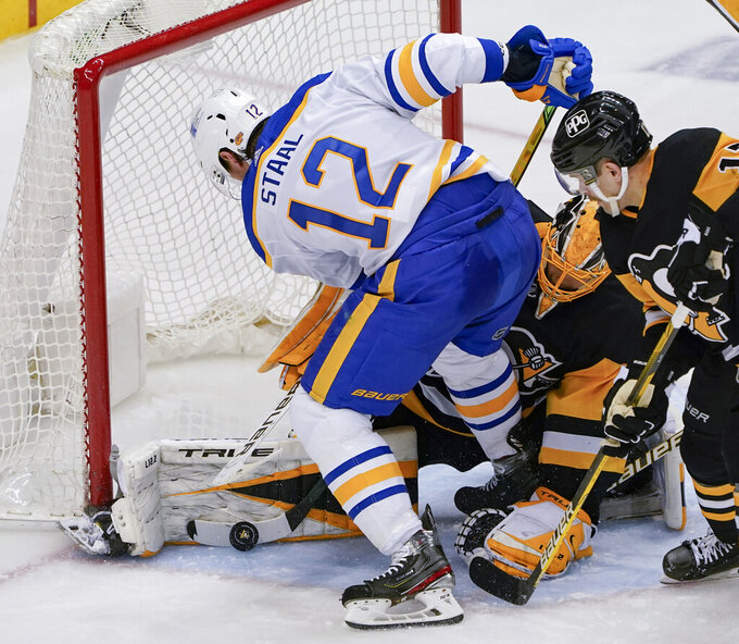 Pittsburgh Penguins goaltender Casey DeSmith, center, stops Buffalo Sabres' Eric Staal (12) from scoring during the third period of an NHL hockey game, Thursday, March 25, 2021, in Pittsburgh. (AP Photo/Keith Srakocic)