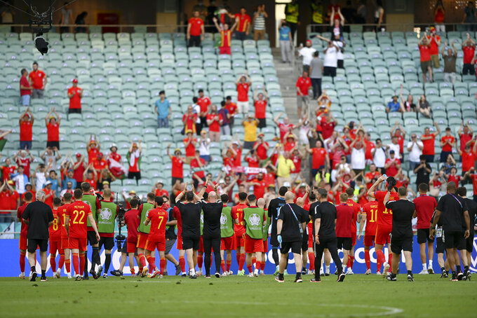 Wales players wave to fans at the end of the Euro 2020 soccer championship group A match between Wales and Switzerland, at the Baku Olympic stadium, in Baku, Azerbaijan, Saturday, June 12, 2021. The match ended 1-1. (Ozan Kose, Pool via AP)
