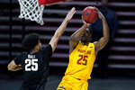Maryland forward Jairus Hamilton, right, shoots against Michigan State forward Malik Hall during the second half of an NCAA college basketball game, Sunday, Feb. 28, 2021, in College Park, Md. Maryland won 73-55. (AP Photo/Julio Cortez)