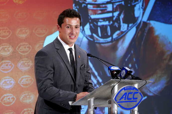 Syracuse's Tommy DeVito speaks during the Atlantic Coast Conference NCAA college football media day in Charlotte, N.C., Wednesday, July 17, 2019. (AP Photo/Chuck Burton)