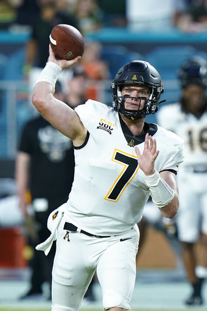 Appalachian State quarterback Chase Brice passes during the first half of an NCAA college football game against Miami, Saturday, Sept. 11, 2021, in Miami Gardens, Fla. (AP Photo/Wilfredo Lee)