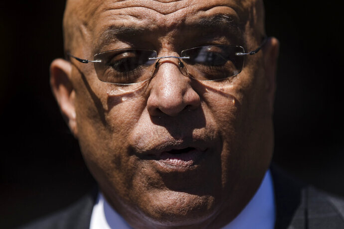 Former Reading Mayor Vaughn Spencer speaks with members of the media as he departs from the federal courthouse in Philadelphia after being sentenced to eight years in prison for trading city contracts for campaign contributions on Wednesday, April 24, 2019. (AP Photo/Matt Rourke)