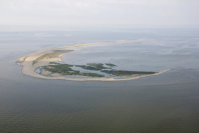 This photo, taken in July 2013 by Karen Westphal and provided by the U.S. Geological Survey, shows Breton Island, off Louisiana at the southern end of the 60-mile-long chain of barrier islands making up the nation's second national wildlife refuge. Work has begun to more than double the area available for nesting seabirds on North Breton Island.  (Karen Westphal/U.S. Geological Survey via AP)