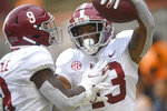 Alabama defensive back Malachi Moore (13) celebrates a touchdown against Tennessee during an NCAA college football game in Knoxville, Tenn., Saturday, Oct. 24, 2020. (Caitie McMekin/Knoxville News Sentinel via AP)