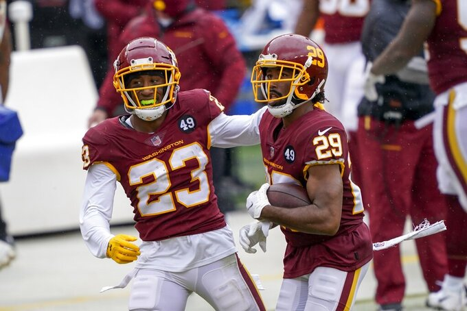 Washington Football Team's Kendall Fuller celebrates his interception with Ronald Darby (23) during the first half of an NFL football game against the Los Angeles Rams Sunday, Oct. 11, 2020, in Landover, Md. (AP Photo/Susan Walsh)