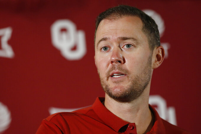 Oklahoma head coach Lincoln Riley answers a question during an NCAA college football media day news conference in Norman, Okla., Friday, Aug. 2, 2019. Riley has done everything his first two years as Oklahoma's coach, including coaching two Heisman winners. But he hasn't won a national title. (AP Photo/Sue Ogrocki)
