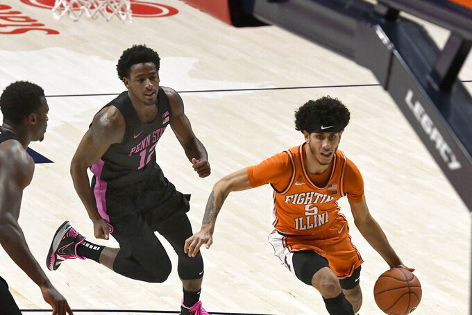Illinois guard Andre Curbelo (5) goes to the basket as Penn State guard Izaiah Brockington (12) defends during the second half of an NCAA college basketball game Tuesday, Jan. 19, 2021, in Champaign, Ill. (AP Photo/Holly Hart)