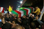 Mourners carry the coffin of Iran's top general Qassem Soleimani during his funeral in Karbala, Iraq, Saturday, Jan. 4, 2020. Iran has vowed