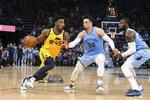 Utah Jazz Donovan Mitchell (45) drives the ball past Memphis Grizzlies' Dillon Brooks (24) during the second half of an NBA basketball game Friday, Nov. 15, 2019, in Memphis, Tenn. (AP Photo/Karen Pulfer Focht)
