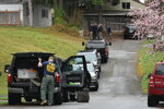 In this March 27, 2018 photo, FBI officials including a bomb technician work near the home of Thanh Cong Phan in Everett, Wash. A federal judge ruled Thursday, July 12, 2018 that Phan, who is accused of mailing explosive devices to government agencies in the Washington, D.C., area, is not competent to help with his defense and should receive treatment before his case moves forward. (Caleb Hutton/The Herald via AP)