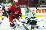 Carolina Hurricanes right wing Andrei Svechnikov (37) shoots, but has it deflected by Dallas Stars goaltender Jake Oettinger (29) during the second period of an NHL hockey game in Raleigh, N.C., Sunday, April 4, 2021. (AP Photo/Gerry Broome)