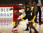 Iowa State forward Solomon Young, left, looks for a pass as Arkansas-Pine Bluff guard Shaun Doss, cente,r and forward Alvin Stredic, right, defend during the first half of an NCAA college basketball game, Sunday, Nov. 29, 2020, in Ames, Iowa. (AP Photo/Matthew Putney)