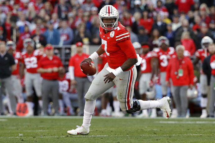 FILE - In this Jan. 1, 2019, file photo, Ohio State quarterback Dwayne Haskins runs against Washington during the first half of the Rose Bowl NCAA college football game, in Pasadena, Calif. Record-setting Ohio State quarterback Dwayne Haskins Jr. says he is leaving school to enter the NFL draft. The third-year sophomore announced Monday, Jan. 7, 2019,  on Twitter that he will depart the program after one year as a starter in which he broke most school and Big Ten single-season passing records. (AP Photo/Jae C. Hong, File)