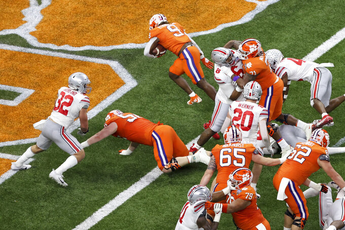 Clemson running back Travis Etienne (9) scores against Ohio State during the first half of the Sugar Bowl NCAA college football game Friday, Jan. 1, 2021, in New Orleans. (AP Photo/Butch Dill)