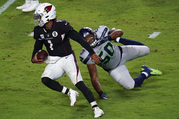 Arizona Cardinals quarterback Kyler Murray (1) breaks the tackle of Seattle Seahawks outside linebacker K.J. Wright (50) for a touchdown during the second half of an NFL football game, Sunday, Oct. 25, 2020, in Glendale, Ariz. (AP Photo/Ross D. Franklin)
